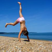 Girl Cartwheel On The Beach