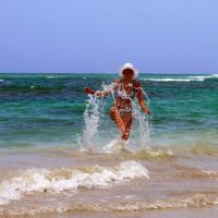 Girl Splashing On The Beach