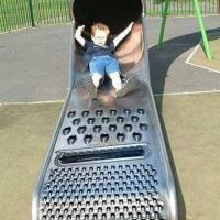 Kid on Shredder-Shaped Slide