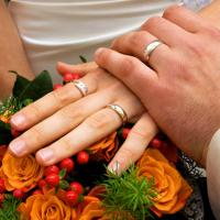 Wedding Rings On Couple