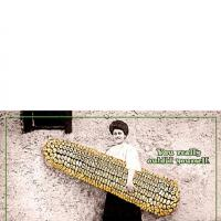 Woman Holding Big Corn