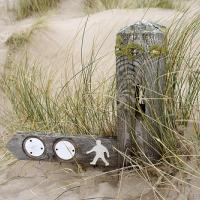 Wooden Signpost Buried In The Sand
